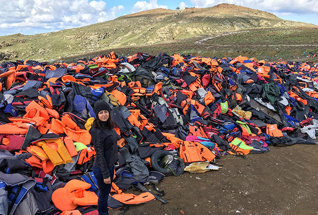 When We Band Together co-founder Zoë Pappis stands among the life vest graveyard. The life vest graveyard is situated on the north end of the Greek Island of Lesvos. Over 1 million refugees have passed through the island since 2014.