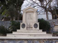 Monument with the bust of Papa Lefteris Noufrakis in Alones