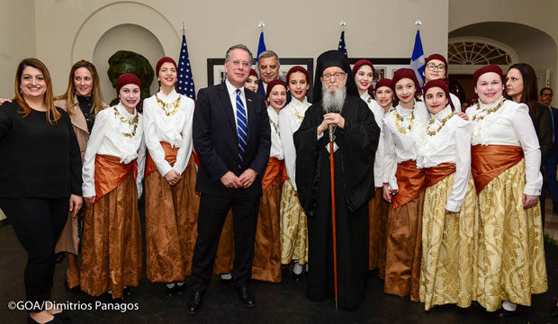 Students wearing traditional costumes, their teachers, Archbishop Demetrios and George Koumoutsakos, New Democracy Shadow Foreign Minister