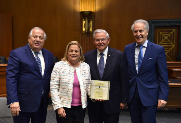 Ranking Member of the Senate Foreign Relations Committee Bob Menendez with (L-R) Philip Christopher, former Chairwoman of the House Foreign Affairs Committee Ileana Ros-Lehtinen, Andy Manatos