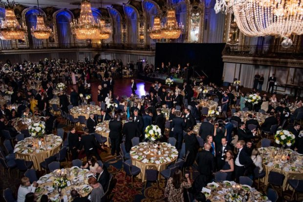 Over 600 guests enjoying dinner at the Hilton Chicago's Grand Ballroom