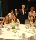 Guest speaker Stellene Volandes, Editor in Chief of Town and Country magazine, with L100 Chairman Argyris Vassiliou, Executive Director Paulette Poulos, and members of the youth at the recent L100 conference. PHOTO: ETA PRESS
