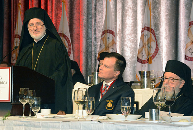 Archbishop Elpidophoros addressing the luncheon. On his left are Mike Emanuel who presented the program, and Archbishop Demetrios, former of America.