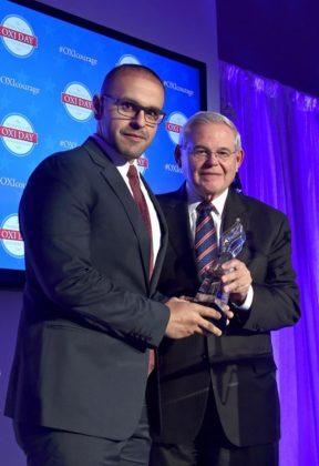 Khashoggi friend and activist Mohamed Soltan accepts the Oxi Courage Award from Senator Bob Menendez