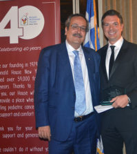 Dr. Spiros Spireas receiving the award from Spiros Maliagros, PHOTO: ETA PRESS