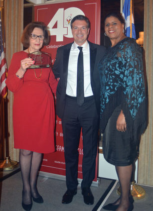Paulette Poulos having received the award from Spiros Maliagros and Ruth C. Browne, PHOTO: ETA PRESS