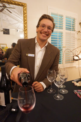 Peter Koros, part of the next generation of the Fotinos Family, pours wine at their 50th anniversary celebration.