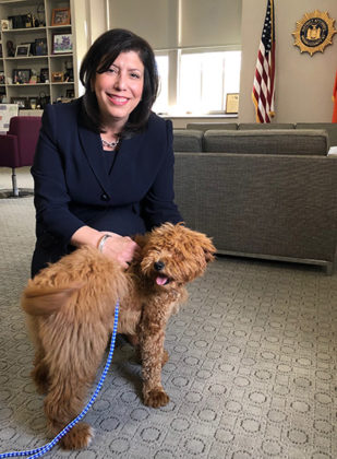 The District Attorney Madeline Singas with a badly abused dog named Bella. The dog's owners were charged with animal cruelty