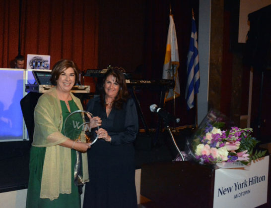 Author and activist Tasoula Hatzitofi receives the WIN award (in a Tiffany crystal) from President Theana Iordanou. PHOTO: ETA PRESS