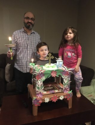 The Dagiantis Family of Naperville, IL built their own Epitaphios, designed by 8 year-old Panayiotis (center). The family processed with it outside on Holy Friday night. PHOTO COURTESY DAGIANTIS FAMILY