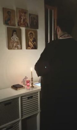 Father Nektarios Karantonis, Associate Priest at St. Nectarios Greek Orthodox Church in Charlotte, NC observes a Nightly Prayer Service for Protection from COVID-19 from his home. FACEBOOK SCREENSHOT