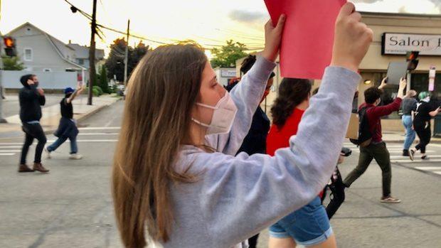 Ellen Efkarpidis protesting against racism in Mineola, Long Island