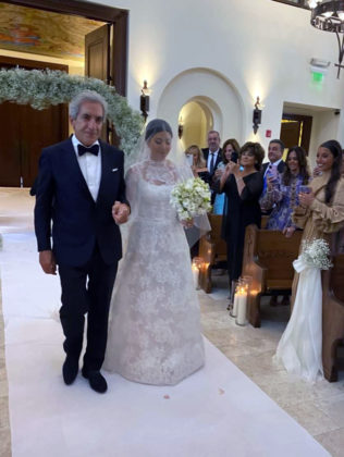 George Pantelidis with daughter Calliope walking down the aisle