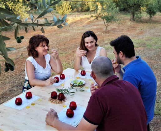 Visitors enjoy an olive oil tasting with Marianna Devetzoglou of Oleosophia (2nd from left). COURTESY OLEOSOPHIA