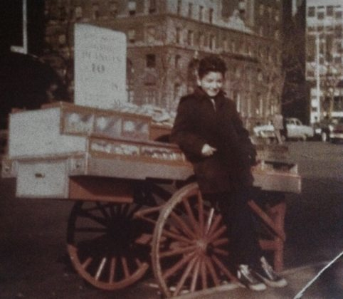 Elias as a young boy was at work with his father, out of a pushcart in Lower Manhattan, near the Customs House